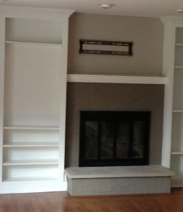 LaffCo. Painting recently painted this brick fireplace.